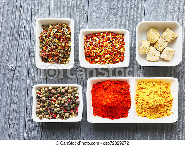 Colorful spices on a dark concrete background - csp72329272