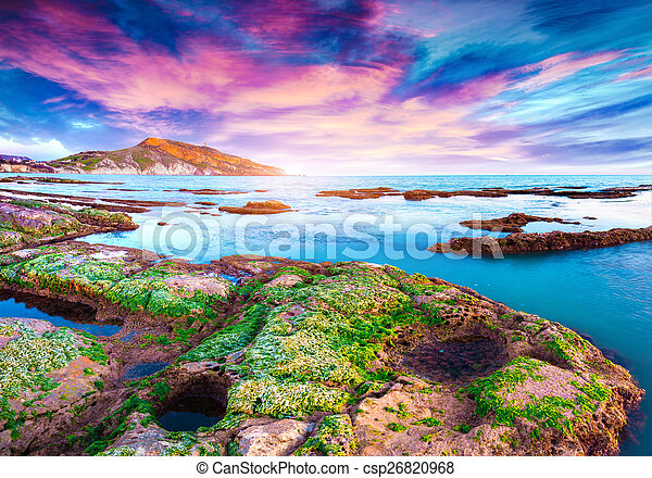 Colorful spring sunset from the Giallonardo beach - csp26820968