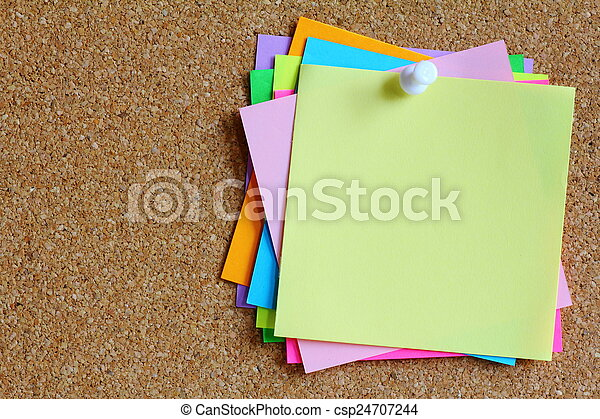 colorful sticky notes on cork bulletin board - csp24707244