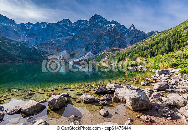 Colorful sunrise at lake in the Tatra Mountains in autumn - csp61475444