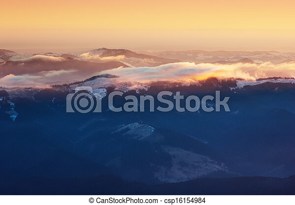 Colorful sunrise in the mountains - csp16154984