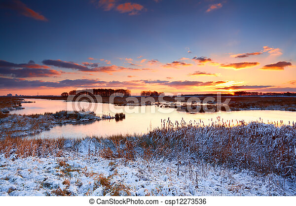 colorful sunrise over river in winter - csp12273536