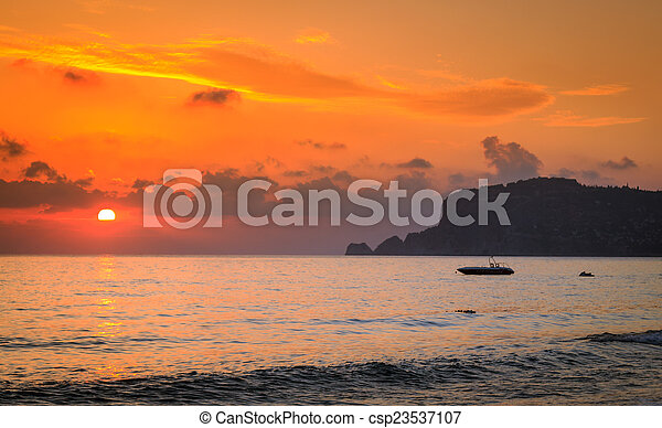 Colorful sunset at the beach in Ala - csp23537107