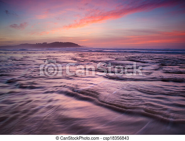 Colorful sunset on the beach - csp18356843