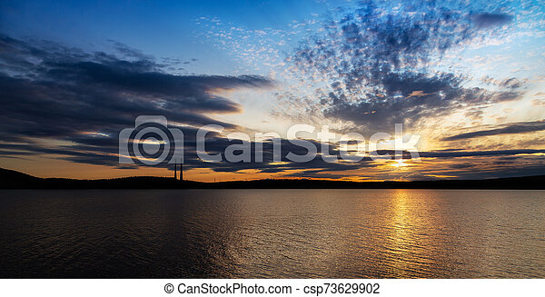 Colorful sunset on the lake - csp73629902