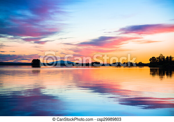 colorful sunset over a calm lake - csp29989803