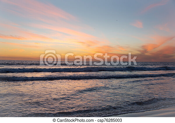 Colorful sunset over a tropical ocean resort - csp76285003