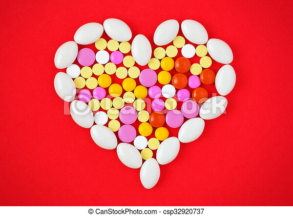 colorful-tablets-arranged-in-a-heart-stock-photos_csp32920737.jpg