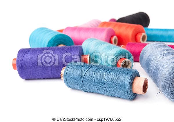 Colorful thread bobbins, isolated - csp19766552