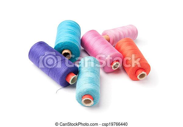 Colorful thread bobbins, isolated - csp19766440