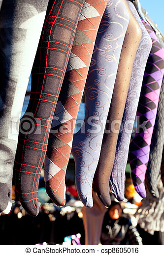 colorful tights in a row hanging in market - csp8605016