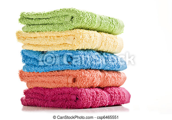 Colorful towels on a white background with space for text - csp6465551