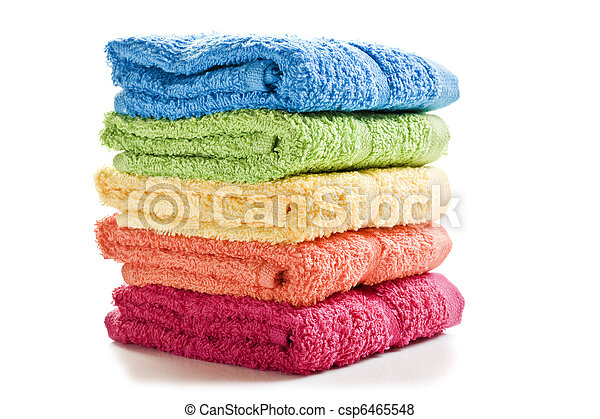 Colorful towels on a white background with space for text - csp6465548
