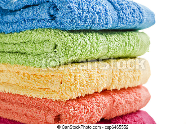 Colorful towels on a white background with space for text - csp6465552