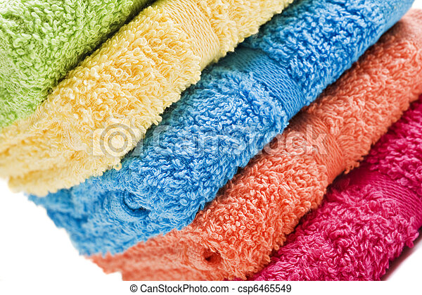 Colorful towels on a white background with space for text - csp6465549