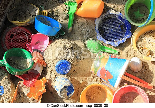colorful toys in a sandpit - csp10038130