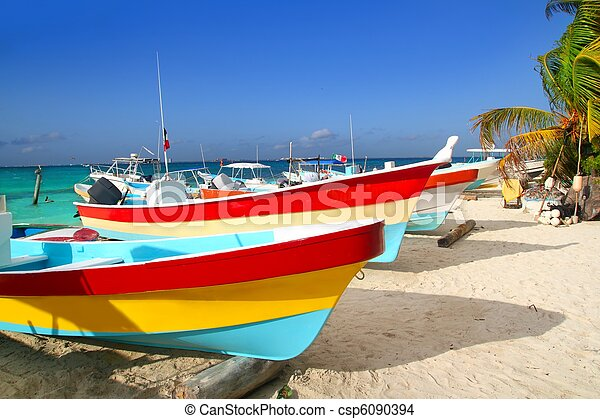 colorful tropical boats beached in sand Isla Mujeres - csp6090394