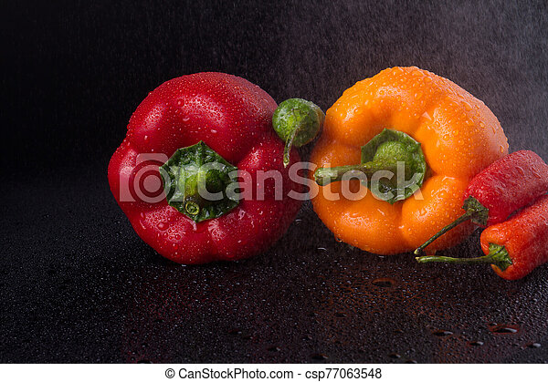 Colorful vegetables under stream of water. - csp77063548