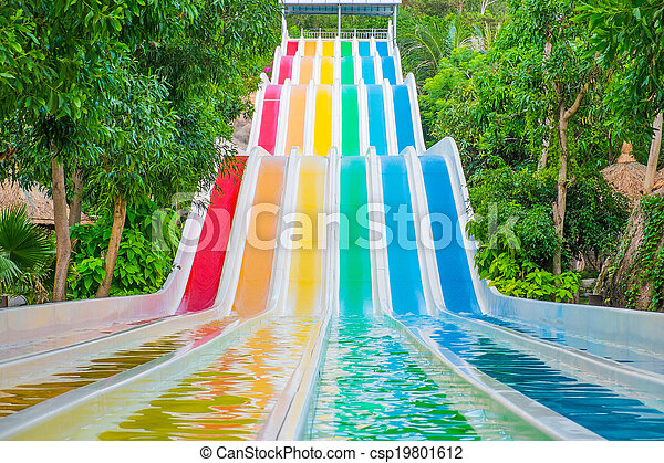 Colorful waterslides in water park - csp19801612
