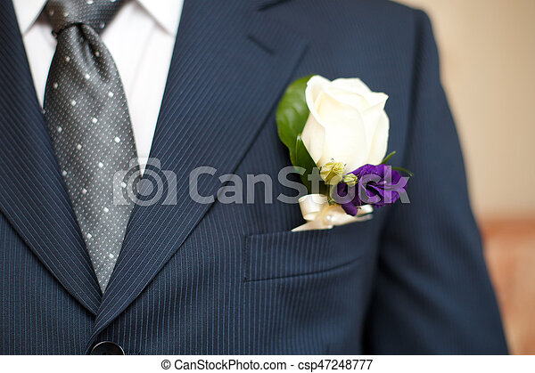 Colorful wedding boutonniere on suit of groom closeup colorful wedding boutonniere on suit of groom csp47248777 junglespirit Images