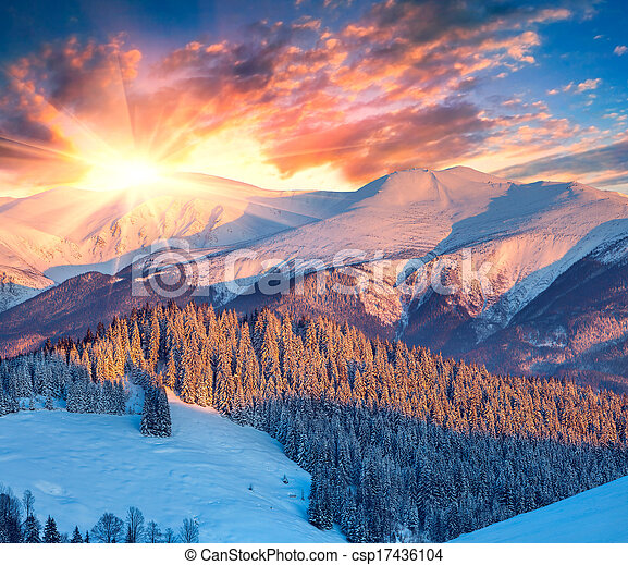 Colorful winter sunrise in mountains. - csp17436104