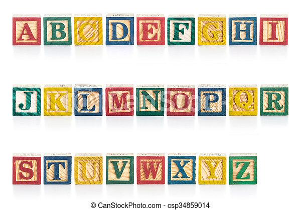 Colorful wood alphabet blocks isolated on white - csp34859014
