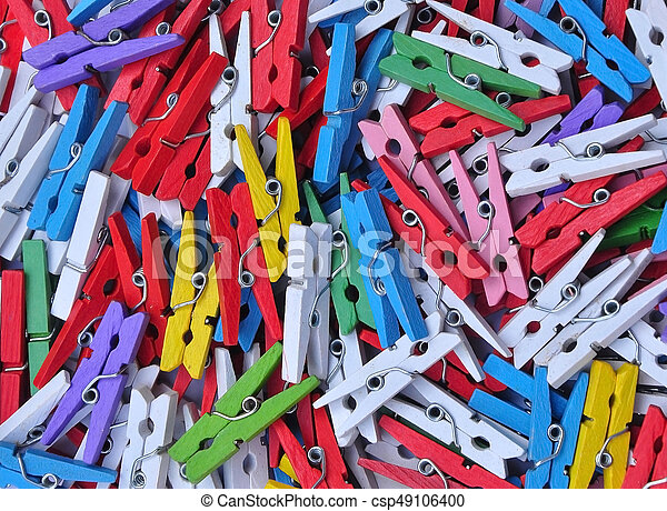 Colorful wooden clothespin on white background - csp49106400