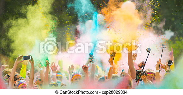 Colorrun competitors in detail of hands - csp28029334