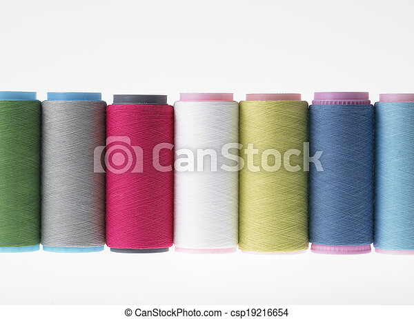 Colors, colorful spools of thread on a white background - csp19216654