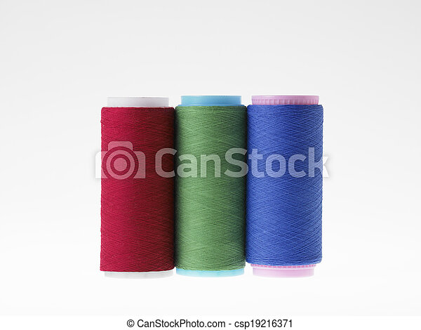 Colors, spools of thread on a white background - csp19216371