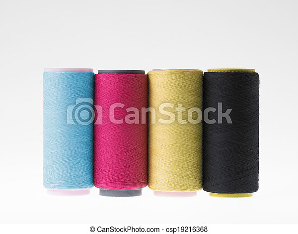 Colors, spools of thread on a white background - csp19216368