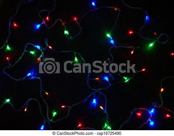 Colour light bulbs on black background - csp16725490