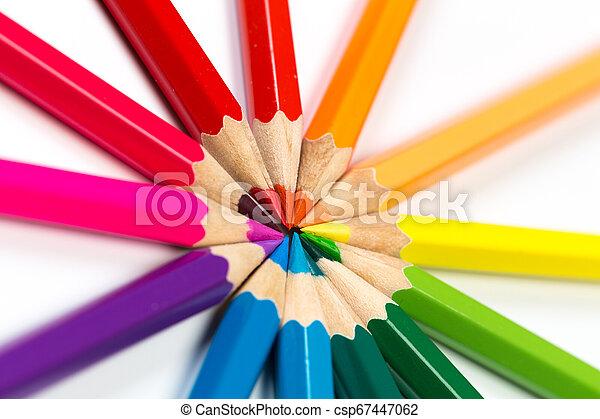 Colour pencils on white background. - csp67447062