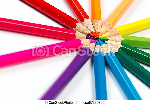Colour pencils on white background. - csp67559329