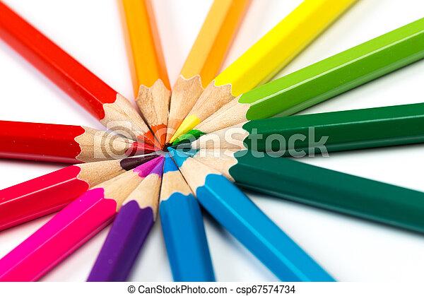Colour pencils on white background. - csp67574734
