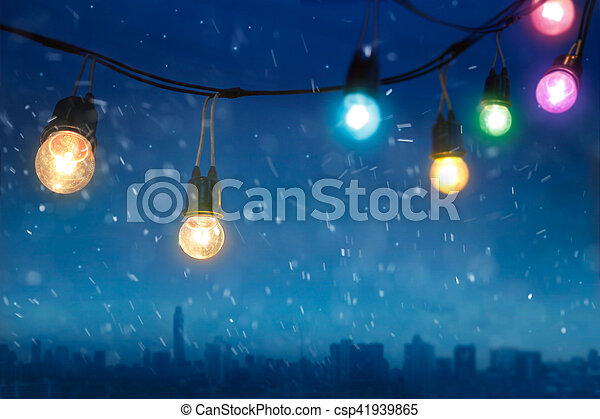 Colourful glowing christmas lights in snowfall on the dark blue city  background - csp41939865 - Colourful Glowing Christmas Lights In Snowfall On The Dark Blue City