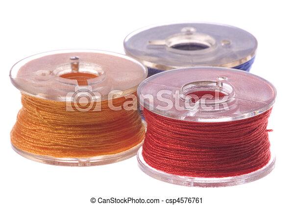 Colourful Thread Bobbins Macro Isolated - csp4576761