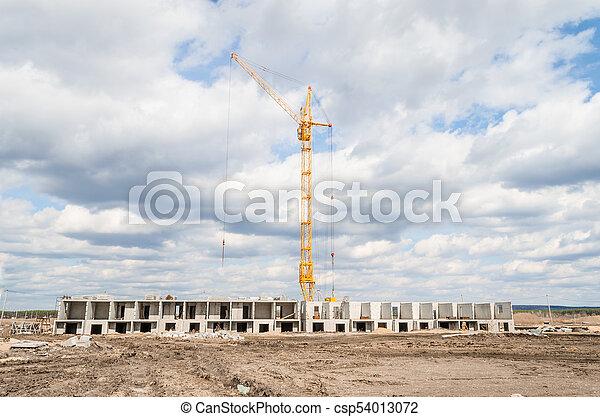 Column crane and new multi-storey building - csp54013072