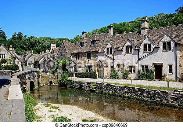 Cottages by stream, Castle combe. - csp39846669