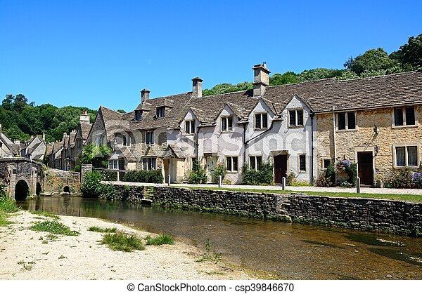 Cottages by stream, Castle combe. - csp39846670