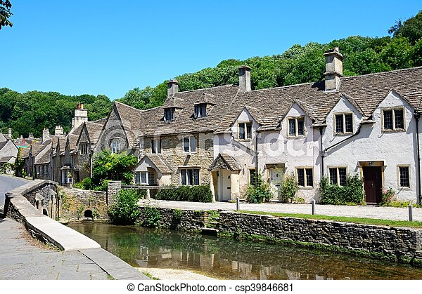 Cottages by stream, Castle combe. - csp39846681