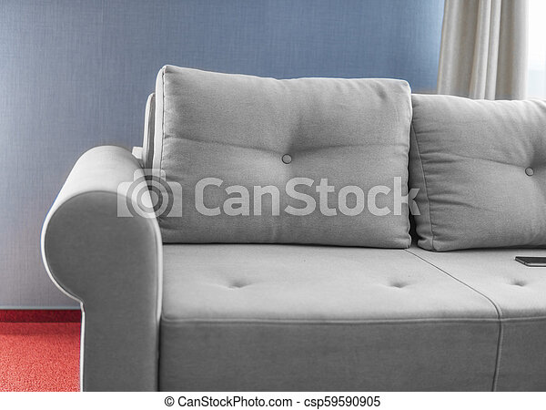 Enjoyable Comfortable Grey Couch In A Living Room With Blue Wall And Red Floor Short Links Chair Design For Home Short Linksinfo
