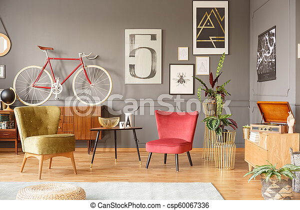 Comfortable vintage armchairs and bicycle - csp60067336