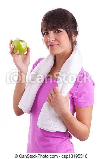 Joven caucásica comiendo una manzana - csp13195516