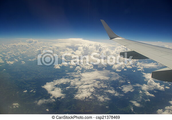 Commercial jet wing & clouds - csp21378469