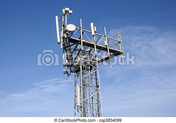 Communications antenna tower against blue sky - csp3834099