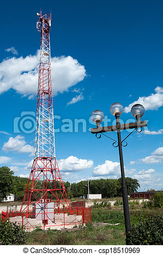 Communications tower against a blue sky - csp18510969