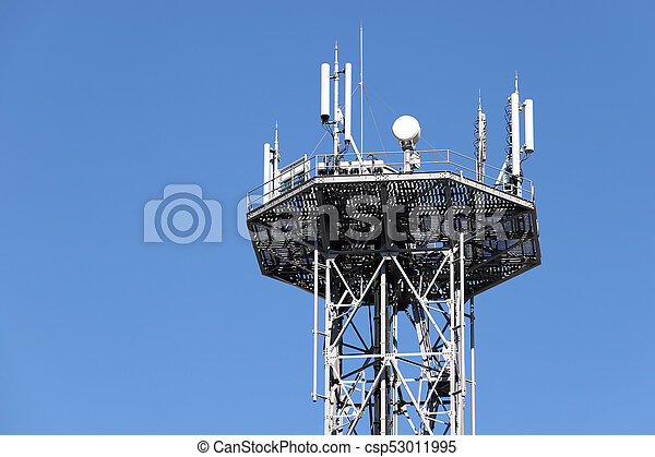 Communications tower against blue sky - csp53011995