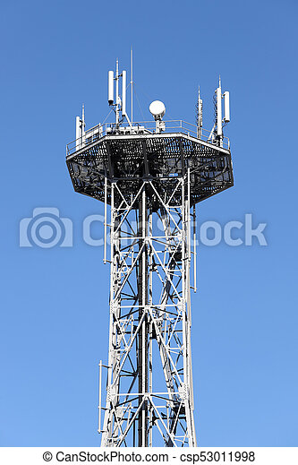 Communications tower against blue sky - csp53011998