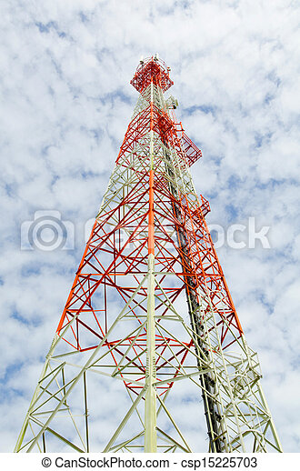 communications tower with antennas against blue sky - csp15225703